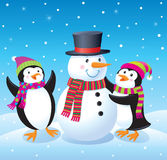 Penguins Making A Snowman Stock Images