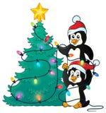 Penguins near Christmas tree theme 1 Stock Photo