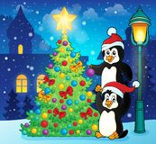 Penguins near Christmas tree theme 3 Stock Image
