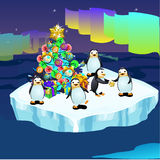 Penguins at the North pole with a Christmas tree Royalty Free Stock Image