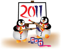 Penguins painting year 2011. Penguins having fun painting year 2011 on canvas Stock Image