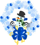 Penguins and a snow wreath Royalty Free Stock Photography