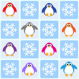 Penguins and snowflakes Stock Images
