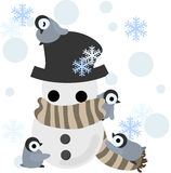 Penguins and a snowman Royalty Free Stock Image