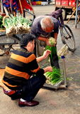 Pengxhou, China: Farmers Weighing Spring Onions Royalty Free Stock Images