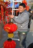 Pengxzhou, China: Man Holding Red Lanterns Stock Photo