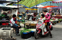 Pengzhou, CH: Woman Shopping at Market Royalty Free Stock Photo