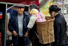 Pengzhou, China: Baby in Wicker Basket Royalty Free Stock Photo