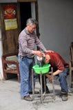 Pengzhou, China: Barber Washing Client's Hair Royalty Free Stock Photo
