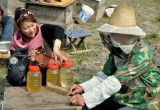 Pengzhou, China:  Beekeepers with Fresh Honey Stock Images