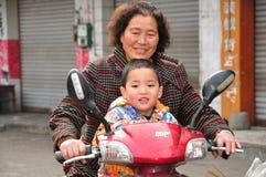 Pengzhou, China: Boy & Grandmom on Motorbike Royalty Free Stock Photos