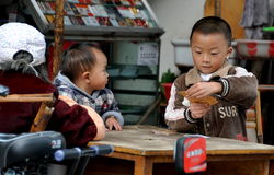 Pengzhou, China: Boy Playing Cards Royalty Free Stock Photos