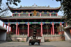 Pengzhou, China: Buddhist Temple. Impressive facade of the Cang Jing Luo hall with its graceful flying eaved roofs and colourfully painted designs at Dong Yuan Stock Photos