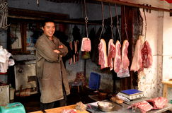 Pengzhou, China:  Butcher with Pork Stock Images