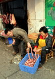 Pengzhou, China:  Butchers with Homemade Sausages Royalty Free Stock Photography