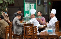Pengzhou, China: Chefs Playing Cards Royalty Free Stock Photo