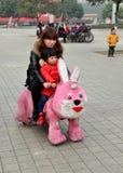 Pengzhou, China: Child with Mother Riding Bunny Cart Royalty Free Stock Photos