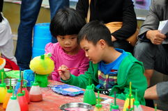 Pengzhou,China: Children Painting Figurine royalty free stock photo