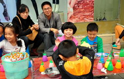 Pengzhou, China: Children Painting Figurines Royalty Free Stock Image