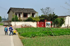 Pengzhou, China: Children Playing on Roadside Stock Photo