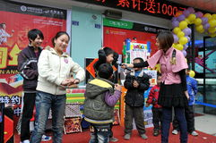 Pengzhou, China: Children at Store Sales Event Stock Images