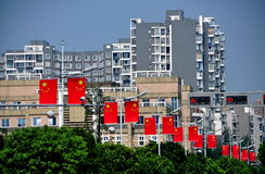 Pengzhou, China: Chinese Flags and Luxury Apartment Buildings Royalty Free Stock Image