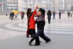Pengzhou, China: Couple Dancing Outdoors in Plaza Stock Images