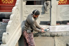 Pengzhou, China: Craftsman at work on Pagoda Stock Photos