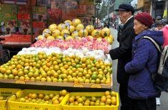 Pengzhou, China: Elderly Couple at Fruit Stand Royalty Free Stock Photo
