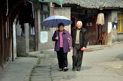 Pengzhou, China: Elderly Couple on Hua Lu Street Stock Image