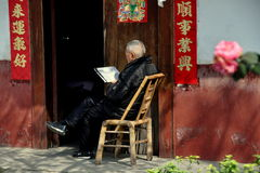 Pengzhou, China: Elderly Man Reading Newspaper Royalty Free Stock Photography