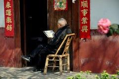 Pengzhou, China: Elderly Man Reading Newspaper Royalty Free Stock Photography