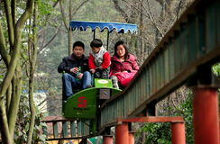 Pengzhou, China: Family at Amusement Park Stock Photo