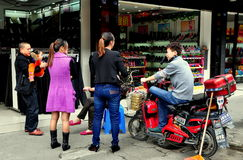 Pengzhou, China: Family Chatting near Shoe Store Royalty Free Stock Photos