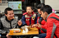 Pengzhou, China: Family Eating at Outdoor Restaurant Stock Photography