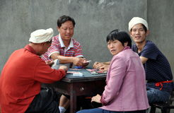 Pengzhou, China: Family Playing Cards Royalty Free Stock Images