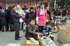 Pengzhou, China: Family Selling Wooden Model Kits Royalty Free Stock Photos
