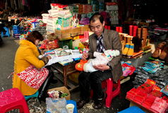 Pengzhou, China: Family at Tian Fu Market Royalty Free Stock Photo