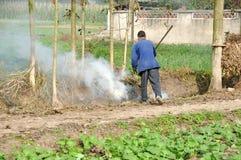 Pengzhou, China: Farmer Burning Refuse Royalty Free Stock Photo