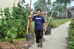 Pengzhou, China: Farmer Carrying Water Buckets Royalty Free Stock Image