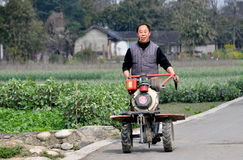 Pengzhou, China: Farmer with Motorised Tiller Stock Photography