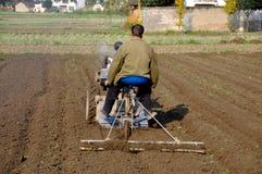 Pengzhou, China: Farmer Plowing Field Royalty Free Stock Images