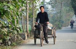 Pengzhou, China:  Farmer Riding Bicycle Cart Royalty Free Stock Photos