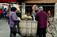 Pengzhou, China: Farmer Selling Cauliflowers Stock Photo