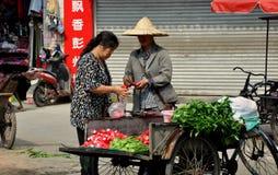 Pengzhou, China: Farmer Selling Radishes Stock Image