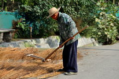 Pengzhou, China: Farmer Using Wooden Tool Royalty Free Stock Photos