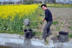 Free Pengzhou, China: Farmer With Water Buckets Royalty Free Stock Photo - 18978925