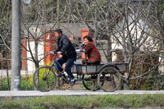 Pengzhou, China: Farmers on Bicycle Cart Royalty Free Stock Image