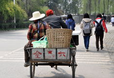Pengzhou, China: Farmers in Bicycle Cart royalty free stock images