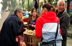 Pengzhou, China: Farmers with Potatoes at Market Royalty Free Stock Images